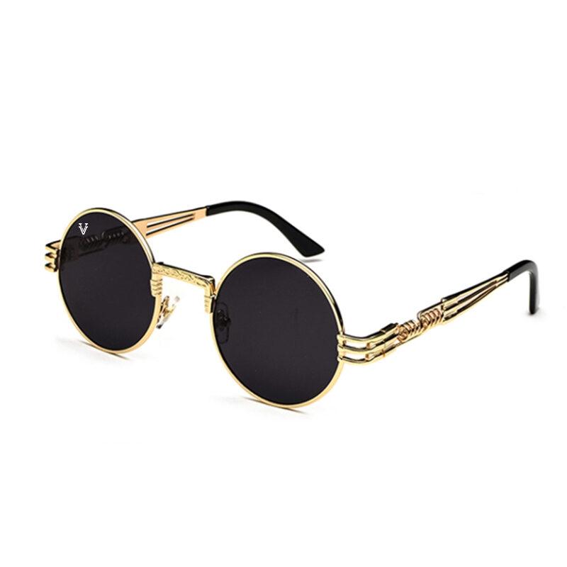 Solglasögon med svart glas och guld båge