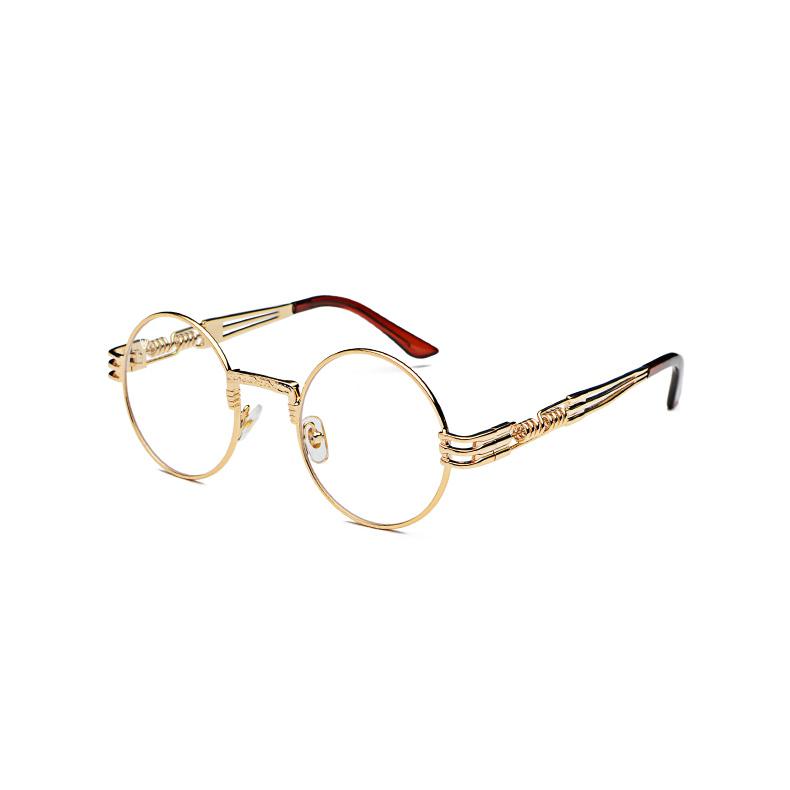 Solglasögon genomskinligt glas och guldbåge